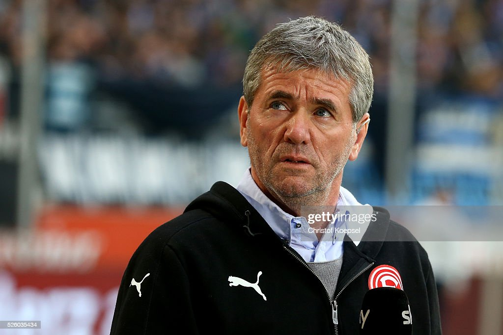 Head coach <a gi-track='captionPersonalityLinkClicked' href=/galleries/search?phrase=Friedhelm+Funkel&family=editorial&specificpeople=649153 ng-click='$event.stopPropagation()'>Friedhelm Funkel</a> of Duesseldorf looks on prior to the 2. Bundesliga match between MSV Duisburg and Fortuna Duesseldorf at Schauinsland-Reisen-Arena on April 29, 2016 in Duisburg, Germany.