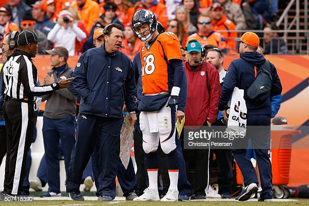 Head coach Gary Kubiak and quarterback Peyton Manning of the Denver Broncos talk during the AFC Championship game against the New England Patriots at...