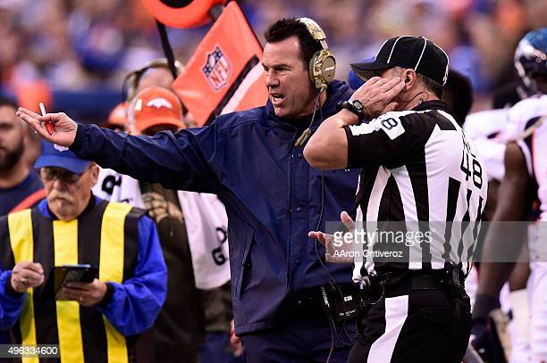 Head coach Gary Kubiak of the Denver Broncos argues a face masking call on his team while playing the Indianapolis Colts during the first half of...