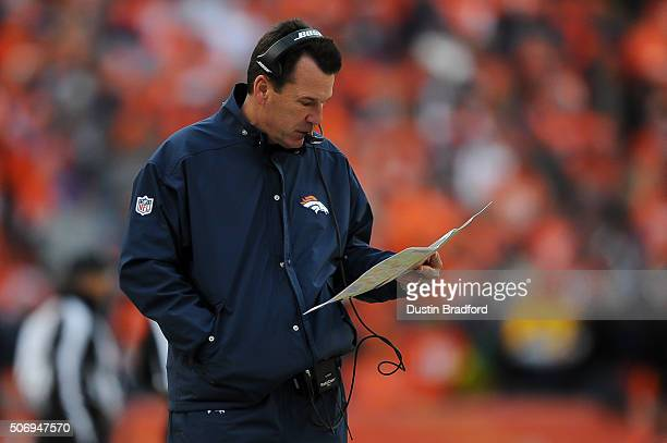 Head coach Gary Kubiak of the Denver Broncos consults his play book in the AFC Championship game against the New England Patriots at Sports Authority...
