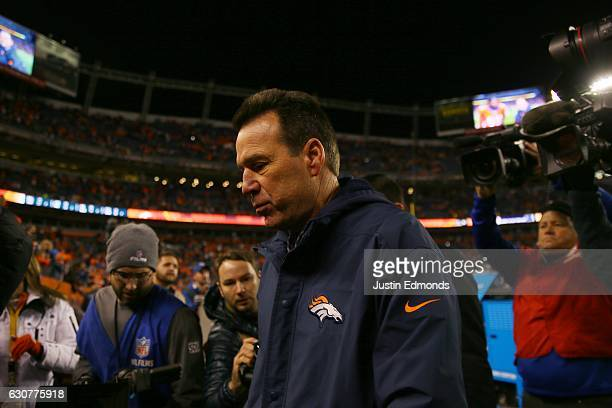 Head coach Gary Kubiak of the Denver Broncos exits the stadium after defeating the Oakland Raiders 246 at Sports Authority Field at Mile High on...