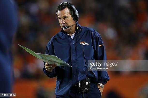 Head coach Gary Kubiak of the Denver Broncos leads his team against the Arizona Cardinals during preseason action at Sports Authority Field at Mile...