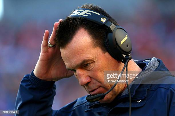 Head coach Gary Kubiak of the Denver Broncos looks on in the first half against the Carolina Panthers during Super Bowl 50 at Levi's Stadium on...