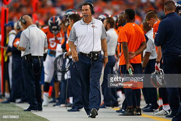 Head coach Gary Kubiak of the Denver Broncos walks the sideline as he leads his team against the San Francisco 49ers during preseason action at...