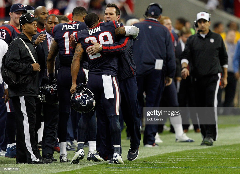 Head coach Gary Kubiak of the Houston Texans celebrates with Glover Quin #29 against the Cincinnati Bengals during their AFC Wild Card Playoff Game at Reliant Stadium on January 5, 2013 in Houston, Texas.