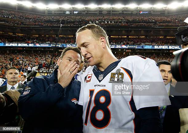 Head coach Gary Kubiak talks with Peyton Manning of the Denver Broncos defeating the Carolina Panthers during Super Bowl 50 at Levi's Stadium on...