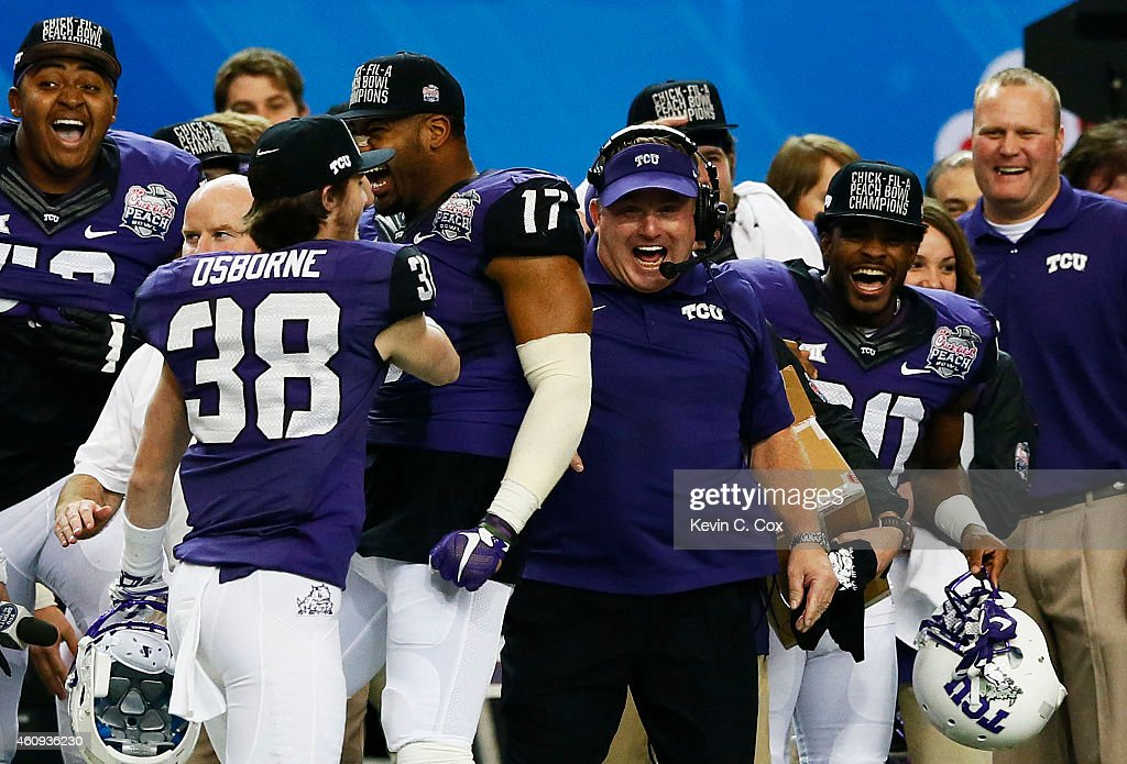 Head coach <a gi-track='captionPersonalityLinkClicked' href=/galleries/search?phrase=Gary+Patterson&family=editorial&specificpeople=2248368 ng-click='$event.stopPropagation()'>Gary Patterson</a> of the TCU Horned Frogs celebrates with his team during their 42 to 3 win over the Ole Miss Rebels during the Chik-fil-A Peach Bowl at Georgia Dome on December 31, 2014 in Atlanta, Georgia.