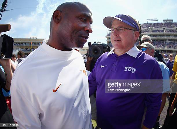 Head coach Gary Patterson of the TCU Horned Frogs greets head coach Charlie Strong of the Texas Longhorns at midfield after the Horned Frogs beat the...