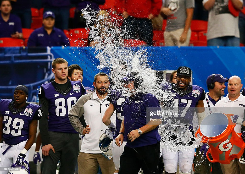 Head coach Gary Patterson of the TCU Horned Frogs is dunked with a Gatorade cooler in the fourth quarter of their win over the Ole Miss Rebels during the Chik-fil-A Peach Bowl at Georgia Dome on December 31, 2014 in Atlanta, Georgia.
