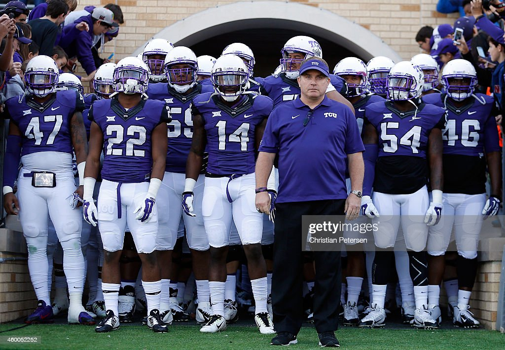 Head coach <a gi-track='captionPersonalityLinkClicked' href=/galleries/search?phrase=Gary+Patterson&family=editorial&specificpeople=2248368 ng-click='$event.stopPropagation()'>Gary Patterson</a> of the TCU Horned Frogs leads his team onto the field before the Big 12 college football game against the Iowa State Cyclones at Amon G. Carter Stadium on December 6, 2014 in Fort Worth, Texas.