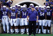 Head coach Gary Patterson of the TCU Horned Frogs leads his team onto the field before the Big 12 college football game against the Iowa State...