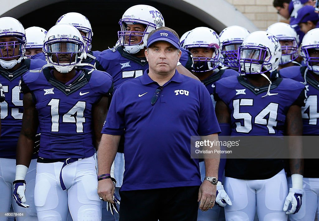 Head coach <a gi-track='captionPersonalityLinkClicked' href=/galleries/search?phrase=Gary+Patterson&family=editorial&specificpeople=2248368 ng-click='$event.stopPropagation()'>Gary Patterson</a> of the TCU Horned Frogs leads his team onto the field before the Big 12 college football game against the Iowa State Cyclones at Amon G. Carter Stadium on December 6, 2014 in Fort Worth, Texas. The Horned Frongs defeated the Cyclones 55-3.