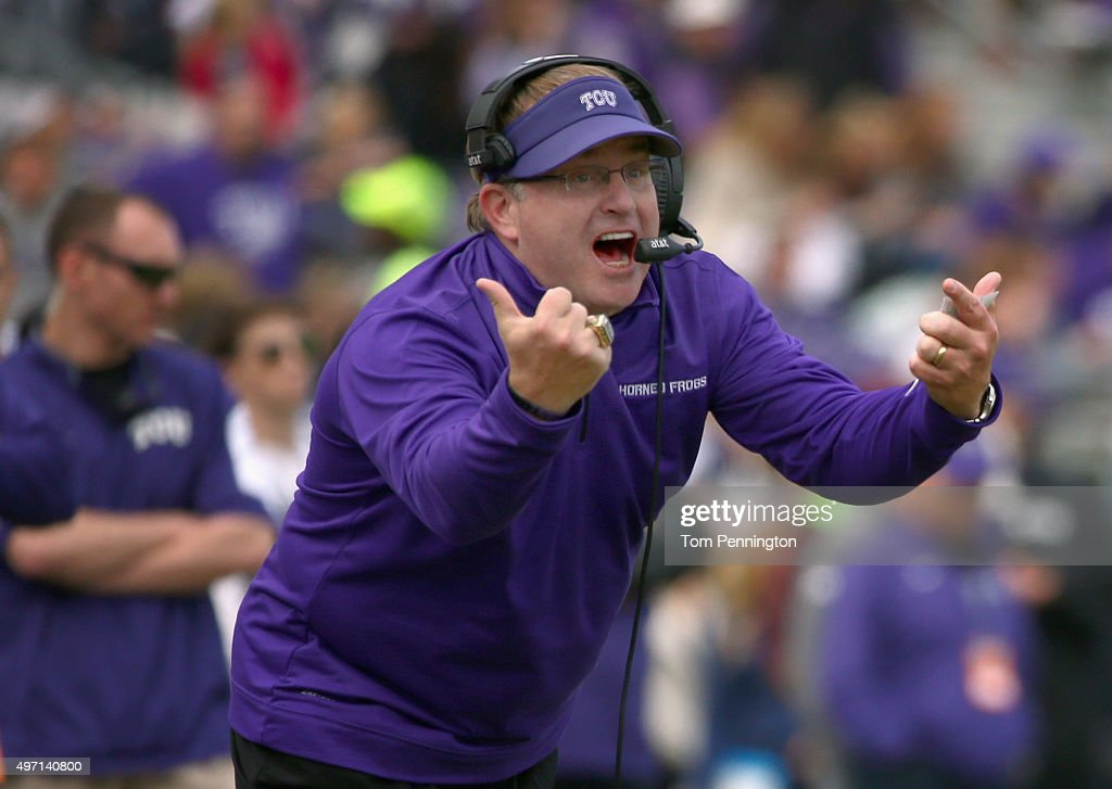 Head coach <a gi-track='captionPersonalityLinkClicked' href=/galleries/search?phrase=Gary+Patterson&family=editorial&specificpeople=2248368 ng-click='$event.stopPropagation()'>Gary Patterson</a> of the TCU Horned Frogs leads the Horned Frogs against the Kansas Jayhawks in the second quarter at Amon G. Carter Stadium on November 14, 2015 in Fort Worth, Texas.
