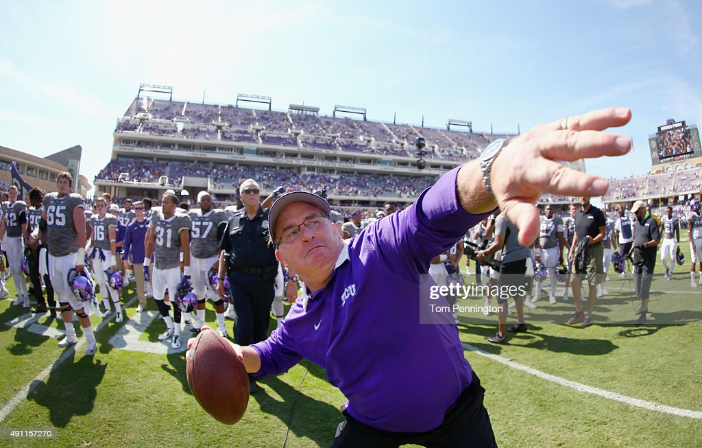 Head coach <a gi-track='captionPersonalityLinkClicked' href=/galleries/search?phrase=Gary+Patterson&family=editorial&specificpeople=2248368 ng-click='$event.stopPropagation()'>Gary Patterson</a> of the TCU Horned Frogs throws a game ball into the stands after the Horned Frogs beat the Texas Longhorns 50-7 at Amon G. Carter Stadium on October 3, 2015 in Fort Worth, Texas.