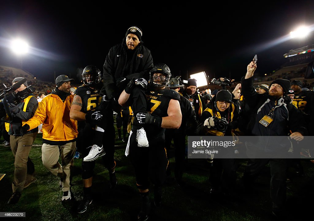 Head coach <a gi-track='captionPersonalityLinkClicked' href=/galleries/search?phrase=Gary+Pinkel&family=editorial&specificpeople=2109950 ng-click='$event.stopPropagation()'>Gary Pinkel</a> of the Missouri Tigers is carried off the field by offensive lineman Brad McNulty #63 and offensive lineman <a gi-track='captionPersonalityLinkClicked' href=/galleries/search?phrase=Evan+Boehm&family=editorial&specificpeople=9839229 ng-click='$event.stopPropagation()'>Evan Boehm</a> #77 after the game against the Tennessee Volunteers at Faurot Field/Memorial Stadium on November 21, 2015 in Columbia, Missouri.