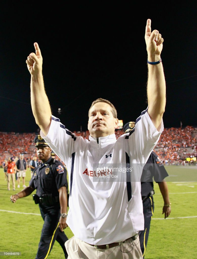 Head coach Gene Chizik of the Auburn Tigers celebrates after their 35-27 win over the South Carolina Gamecocks at Jordan-Hare Stadium on September 25, 2010 in Auburn, Alabama.