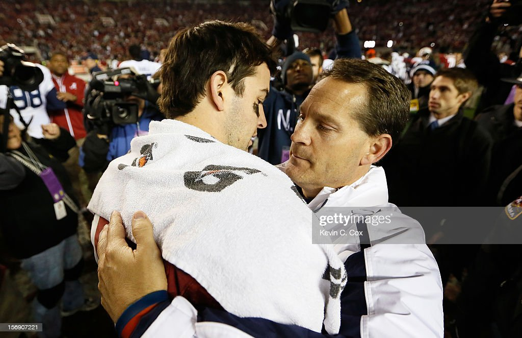 Head coach <a gi-track='captionPersonalityLinkClicked' href=/galleries/search?phrase=Gene+Chizik&family=editorial&specificpeople=5373225 ng-click='$event.stopPropagation()'>Gene Chizik</a> of the Auburn Tigers congratulates AJ McCarron #10 of the Alabama Crimson Tide on their 49-0 win at Bryant-Denny Stadium on November 24, 2012 in Tuscaloosa, Alabama.