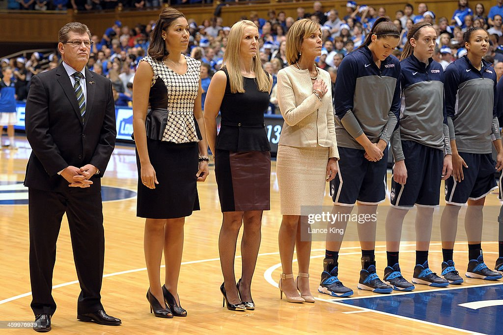 Head Coach Geno Auriemma, Assistant Coach Marisa Moseley, Assistant Coach Shea Ralph, Associate Head Coach Chris Dailey, Stefanie Dolson #31, Breanna Stewart #30 and Kiah Stokes #41 of the Connecticut Huskies stand at attention during the National Anthem prior to a game against the Duke Blue Devils at Cameron Indoor Stadium on December 17, 2013 in Durham, North Carolina. Connecticut defeated Duke 83-61.