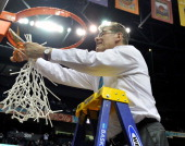 Head coach Geno Auriemma cuts down the nets after a 7958 victory over the Notre Dame Fighting Irish in the NCAA Women's Basketball Tournament...