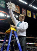 Head coach Geno Auriemma holds up the nets after a 7958 victory over the Notre Dame Fighting Irish in the NCAA Women's Basketball Tournament...
