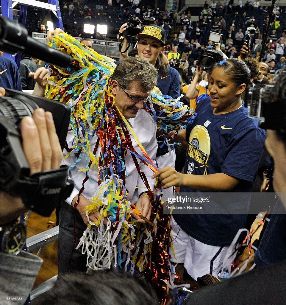 Head coach Geno Auriemma is covered in confetti by Kaleena Mosqueda and Stefanie Dolson after a 79-58 victory over the Notre Dame Fighting Irish in the NCAA Women's Basketball Tournament Championship game at Bridgestone Arena on April 8, 2014 in Nashville, Tennessee.