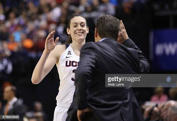 Head coach Geno Auriemma of the Connecticut Huskies and Breanna Stewart celebrate their 8051 win over the Oregon State Beavers during the semifinals...