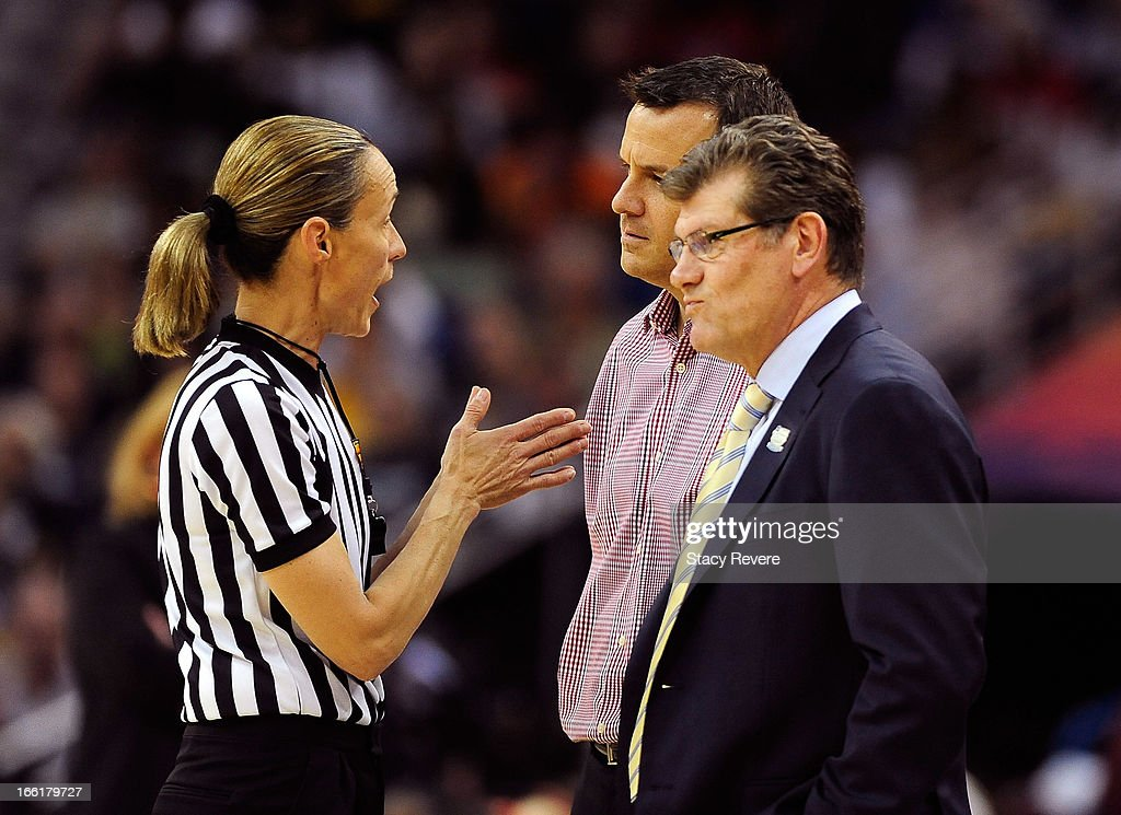 Head coach Geno Auriemma of the Connecticut Huskies and head coach Jeff Walz of the Louisville Cardinals speak to an official after a flagrant foul call in the first half during the 2013 NCAA Women's Final Four Championship at New Orleans Arena on April 9, 2013 in New Orleans, Louisiana.