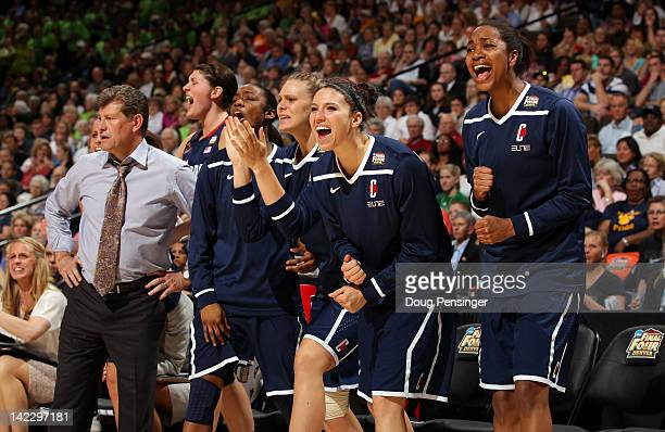 Head coach Geno Auriemma of the Connecticut Huskies and his players react on the bench in the second half against the Notre Dame Fighting Irish...