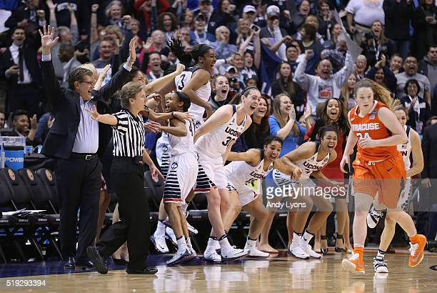 head coach Geno Auriemma of the Connecticut Huskies Breanna Stewart Morgan Tuck Moriah Jefferson Gabby Williams and Napheesa Collier celebrate from...