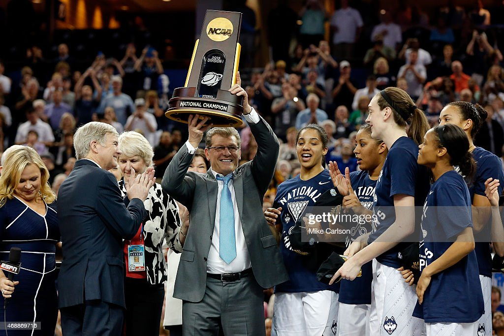 Head coach <a gi-track='captionPersonalityLinkClicked' href=/galleries/search?phrase=Geno+Auriemma&family=editorial&specificpeople=704607 ng-click='$event.stopPropagation()'>Geno Auriemma</a> of the Connecticut Huskies celebrates with the trophy on stage after defeating the Notre Dame Fighting Irish 63-53 during the NCAA Women's Final Four National Championship at Amalie Arena on April 7, 2015 in Tampa, Florida.