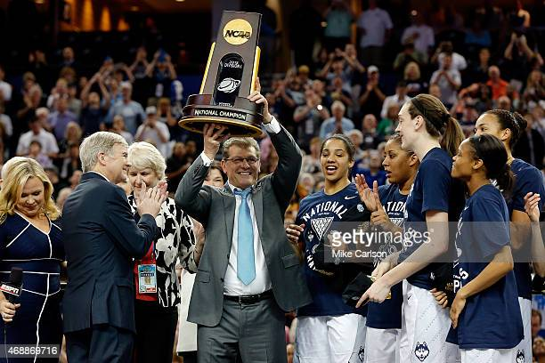 Head coach Geno Auriemma of the Connecticut Huskies celebrates with the trophy on stage after defeating the Notre Dame Fighting Irish 6353 during the...