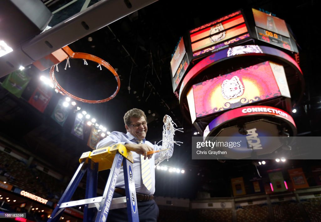 Head coach <a gi-track='captionPersonalityLinkClicked' href=/galleries/search?phrase=Geno+Auriemma&family=editorial&specificpeople=704607 ng-click='$event.stopPropagation()'>Geno Auriemma</a> of the Connecticut Huskies cuts down the net after defeating the Louisville Cardinals during the 2013 NCAA Women's Final Four Championship at New Orleans Arena on April 9, 2013 in New Orleans, Louisiana.