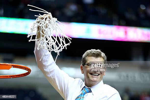 Head coach Geno Auriemma of the Connecticut Huskies cuts down the net after defeating the Notre Dame Fighting Irish 79 to 58 in the NCAA Women's...