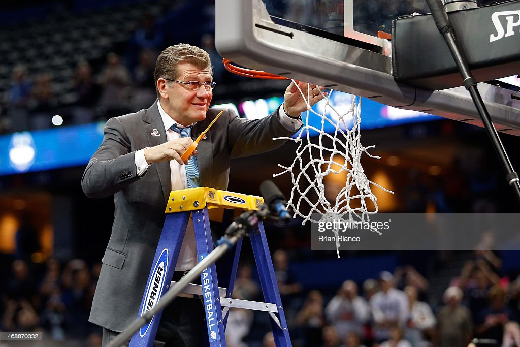 Head coach <a gi-track='captionPersonalityLinkClicked' href=/galleries/search?phrase=Geno+Auriemma&family=editorial&specificpeople=704607 ng-click='$event.stopPropagation()'>Geno Auriemma</a> of the Connecticut Huskies cuts the net after defeating the Notre Dame Fighting Irish 63-53 during the NCAA Women's Final Four National Championship at Amalie Arena on April 7, 2015 in Tampa, Florida.