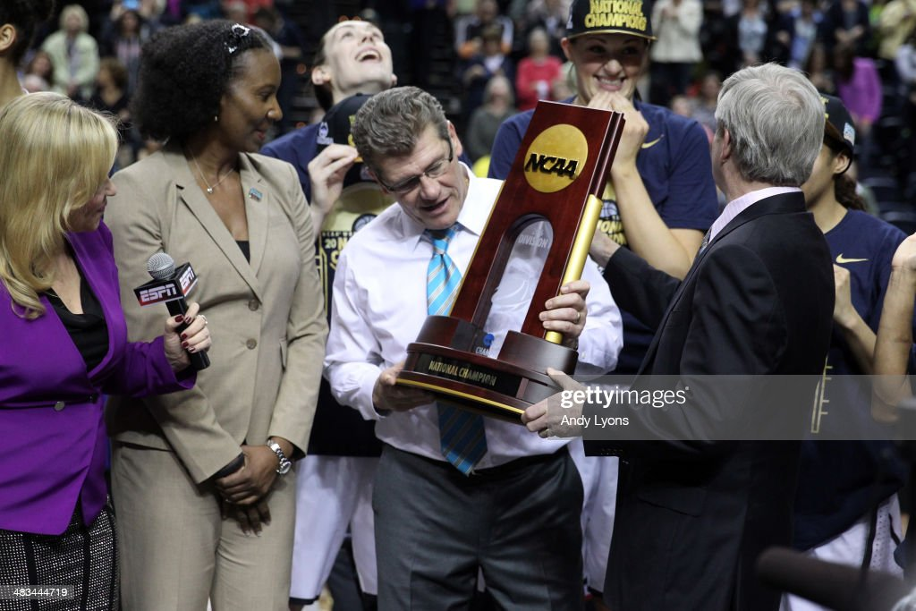 Head coach Geno Auriemma of the Connecticut Huskies holds the trophy after defeating the Notre Dame Fighting Irish 79 to 58 in the NCAA Women's Final Four Championship at Bridgestone Arena on April 8, 2014 in Nashville, Tennessee.