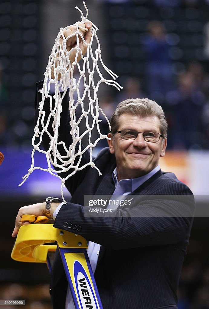 Head coach <a gi-track='captionPersonalityLinkClicked' href=/galleries/search?phrase=Geno+Auriemma&family=editorial&specificpeople=704607 ng-click='$event.stopPropagation()'>Geno Auriemma</a> of the Connecticut Huskies holds up the net after cutting it down following their 82-51 victory over the Syracuse Orange to win the 2016 NCAA Women's Final Four Basketball Championship at Bankers Life Fieldhouse on April 5, 2016 in Indianapolis, Indiana.