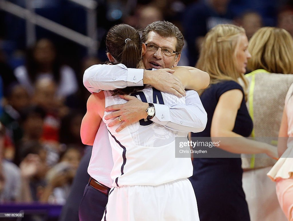 Head coach Geno Auriemma of the Connecticut Huskies hugs Kelly Faris #34 as she exits the game in the second half against the Louisville Cardinals during the 2013 NCAA Women's Final Four Championship at New Orleans Arena on April 9, 2013 in New Orleans, Louisiana.