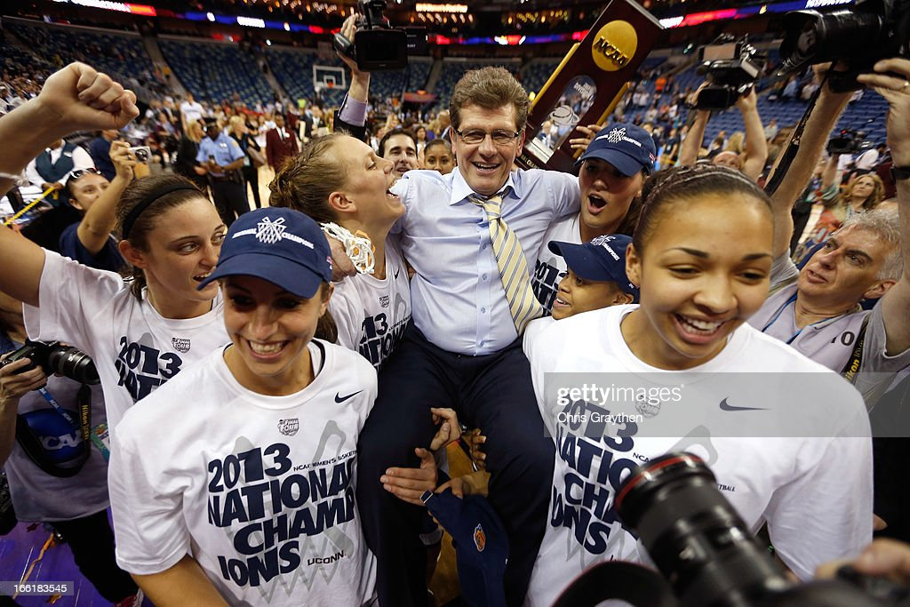 Head coach <a gi-track='captionPersonalityLinkClicked' href=/galleries/search?phrase=Geno+Auriemma&family=editorial&specificpeople=704607 ng-click='$event.stopPropagation()'>Geno Auriemma</a> of the Connecticut Huskies is carried off the court by his players after defeating the Louisville Cardinals winning his eighth National Championship during the 2013 NCAA Women's Final Four Championship at New Orleans Arena on April 9, 2013 in New Orleans, Louisiana.