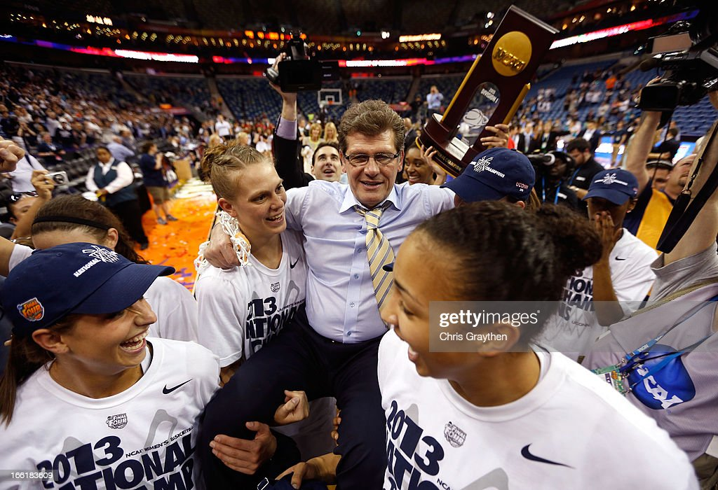 Head coach Geno Auriemma of the Connecticut Huskies is carried off the court by his players after defeating the Louisville Cardinals winning his eighth National Championship during the 2013 NCAA Women's Final Four Championship at New Orleans Arena on April 9, 2013 in New Orleans, Louisiana.
