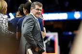 Head coach Geno Auriemma of the Connecticut Huskies looks on from the stage after defeating the Notre Dame Fighting Irish 6353 during the NCAA...