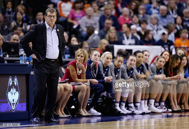 Head coach Geno Auriemma of the Connecticut Huskies looks on in the first quarter against the Syracuse Orange during the championship game of the...