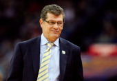 Head coach Geno Auriemma of the Connecticut Huskies reacts to a play in the first half against the Louisville Cardinals during the 2013 NCAA Women's...