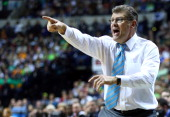 Head coach Geno Auriemma of the Connecticut Huskies shouts to the players against the Notre Dame Fighting Irish in the first half during the NCAA...