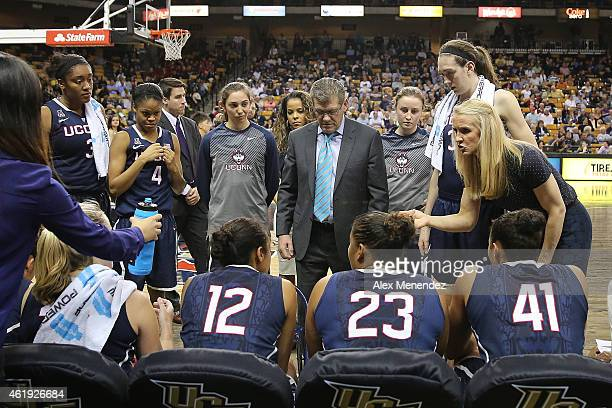Head coach Geno Auriemma of the Connecticut Huskies speaks to his team during a timeout of an NCAA women's basketball game against the UCF Knights at...