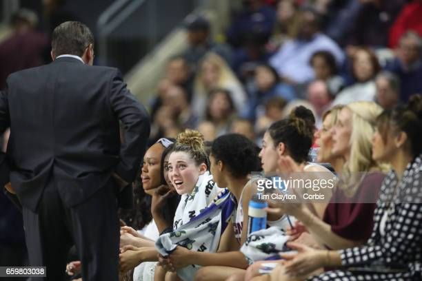 Head coach Geno Auriemma of the Connecticut Huskies talking to his starters Katie Lou Samuelson of the Connecticut Huskies Gabby Williams of the...