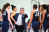 Head coach Geno Auriemma of the Connecticut Huskies talks to his players during the first half against the Colgate Raiders on December 9 2015 at...