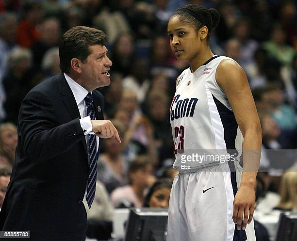 Head coach Geno Auriemma of the Connecticut Huskies talks with Maya Moore in the first half against the Louisville Cardinals on April 7 2009 during...