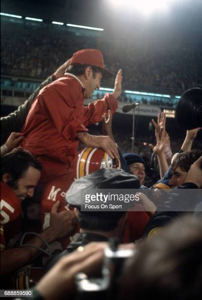 Head coach George Allen of the Washington Redskins gets carried off the field by his players after victory of an NFL football game circa 1972 at RFK...