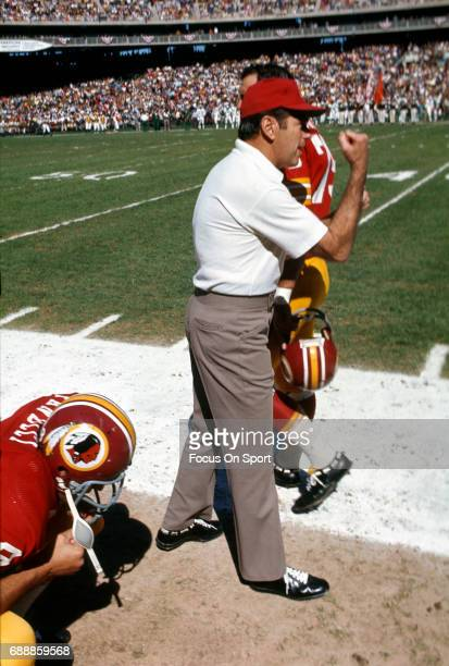 Head coach George Allen of the Washington Redskins looks on during player introduction prior to the start of an NFL football game circa 1972 at RFK...