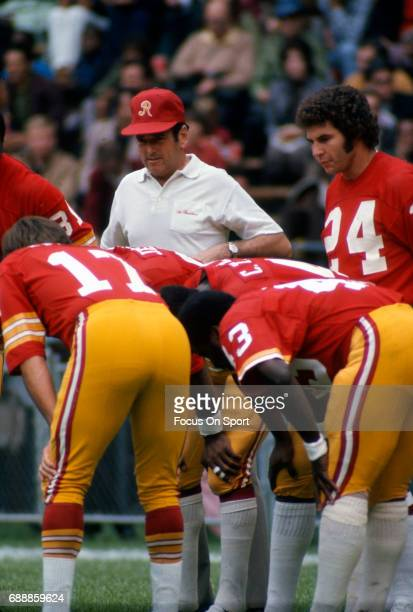 Head coach George Allen of the Washington Redskins looks on during pregame warmups prior to the start of an NFL football game circa 1971 at RFK...